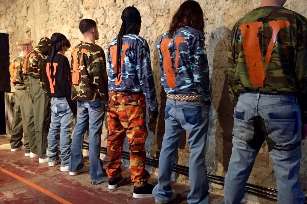 boys wearing vlone t shirt and hoodie with jeans